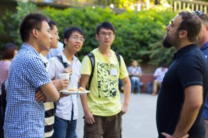 students talking to professor outdoors